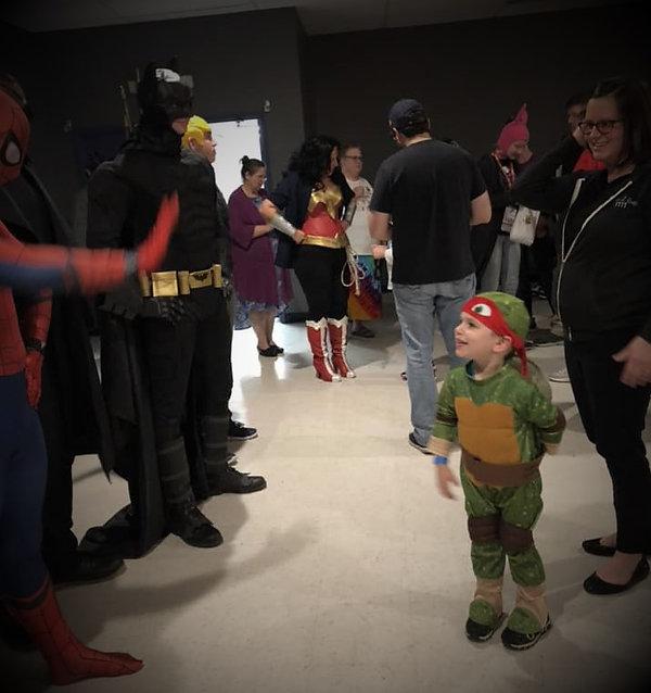 heroes and kid.jpg