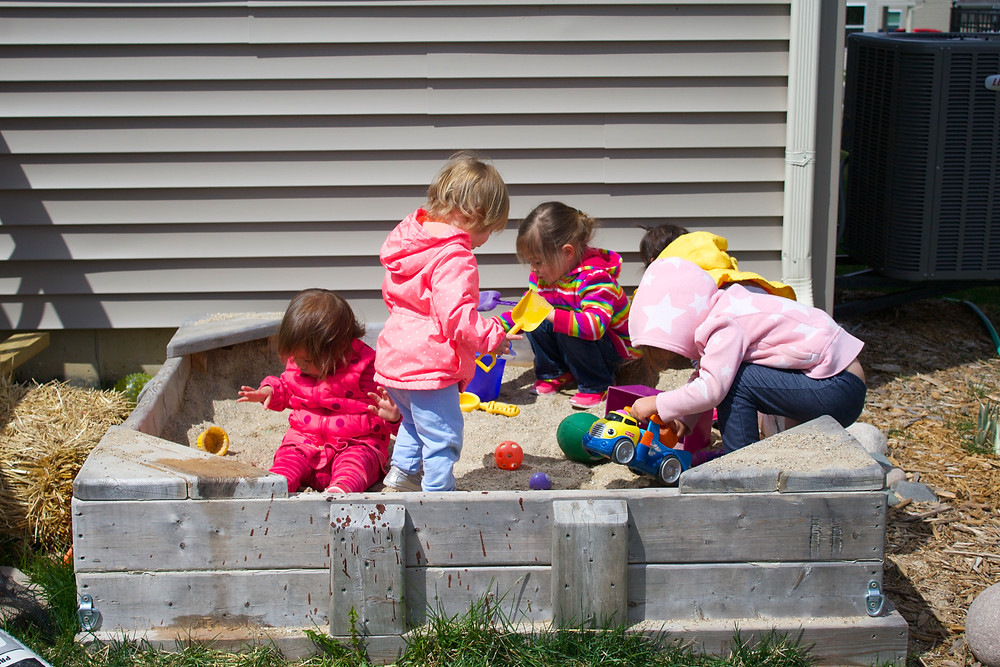 Blue Sky Daycare home daycare children playing in the sandbox