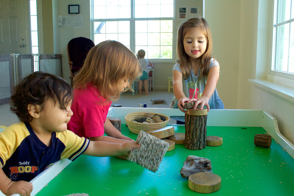 Blue Sky Daycare home daycare children have fun creating with blocks