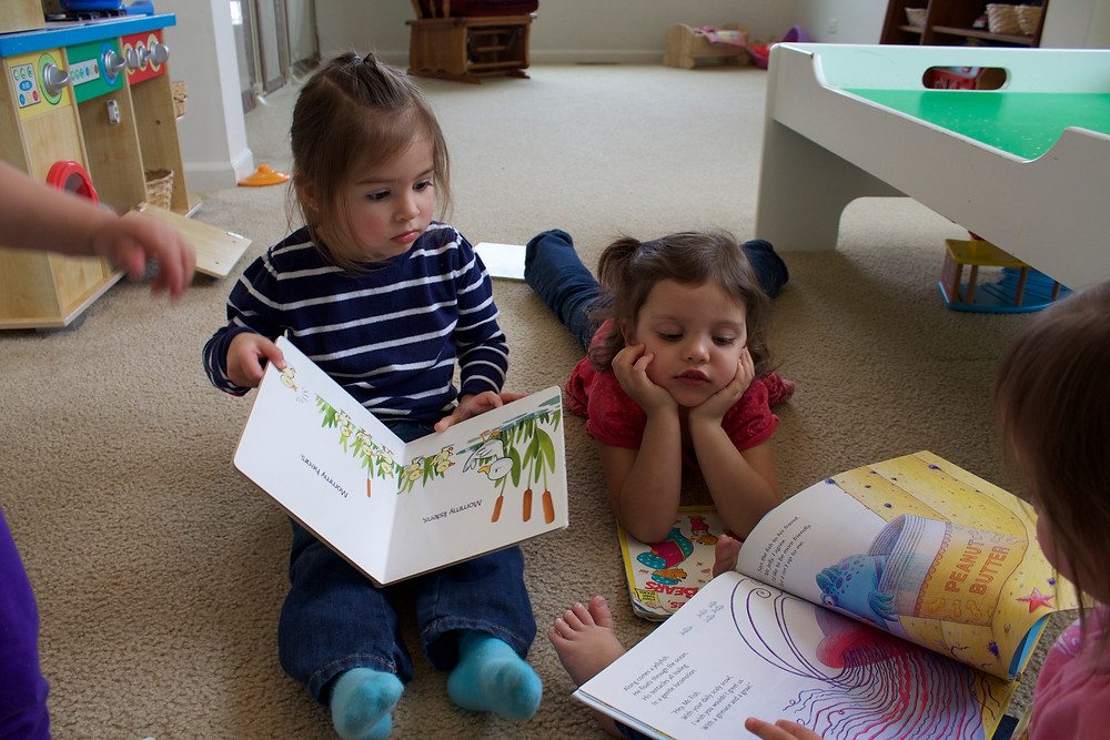 Blue Sky Daycare children check out some good books