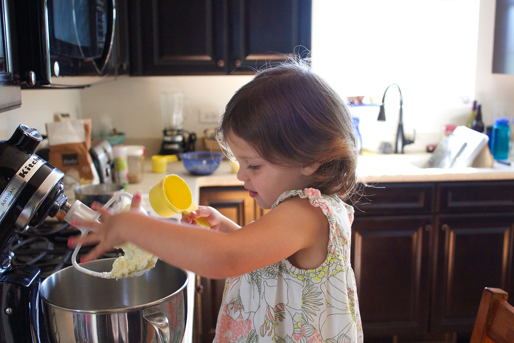 Making cookies for May Day Tea at Blue Sky Daycare home daycare