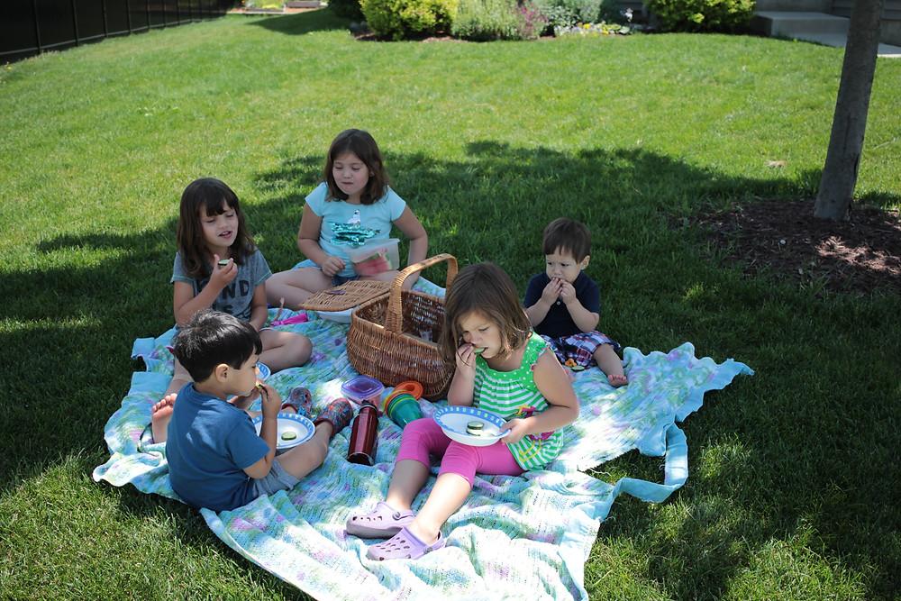 Blue Sky Daycare children enjoy a picnic on National Picnic Day!