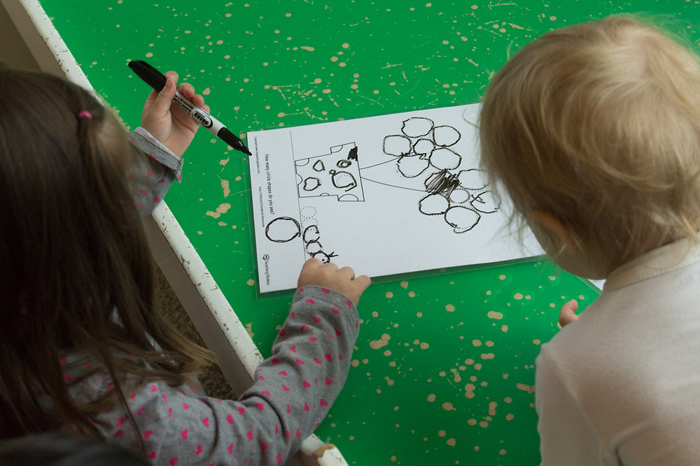 Blue Sky Dacyare children practice fine motor control as they trace a picture