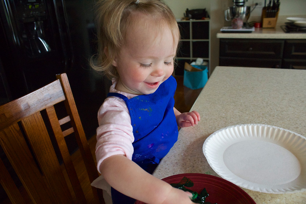 Sensory fun while fingerpainting at Blue Sky Daycare home daycare