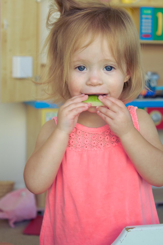 A Blue Sky Daycare child participates in an apple taste test
