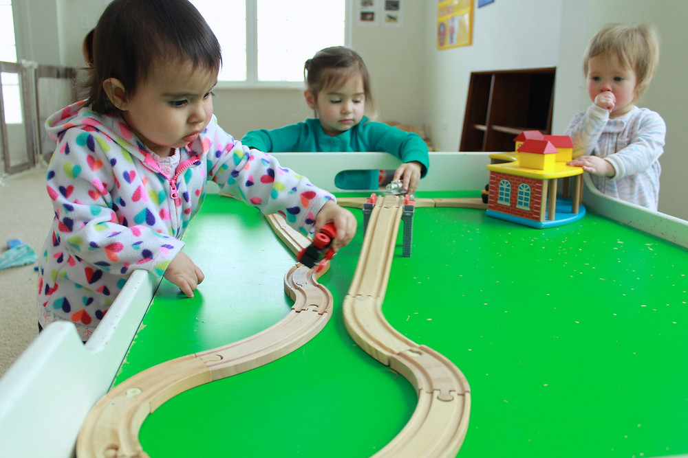 Blue Sky Daycare children playing trains