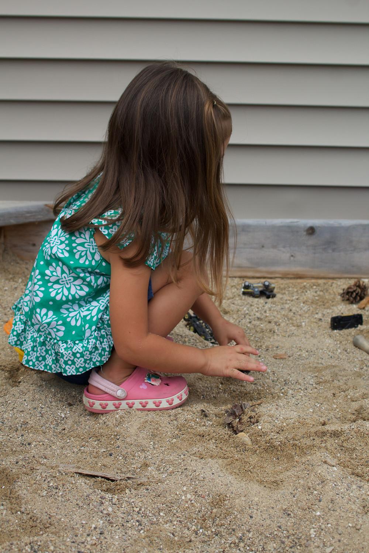 Blue Sky Daycare home daycare children enjoy sand play