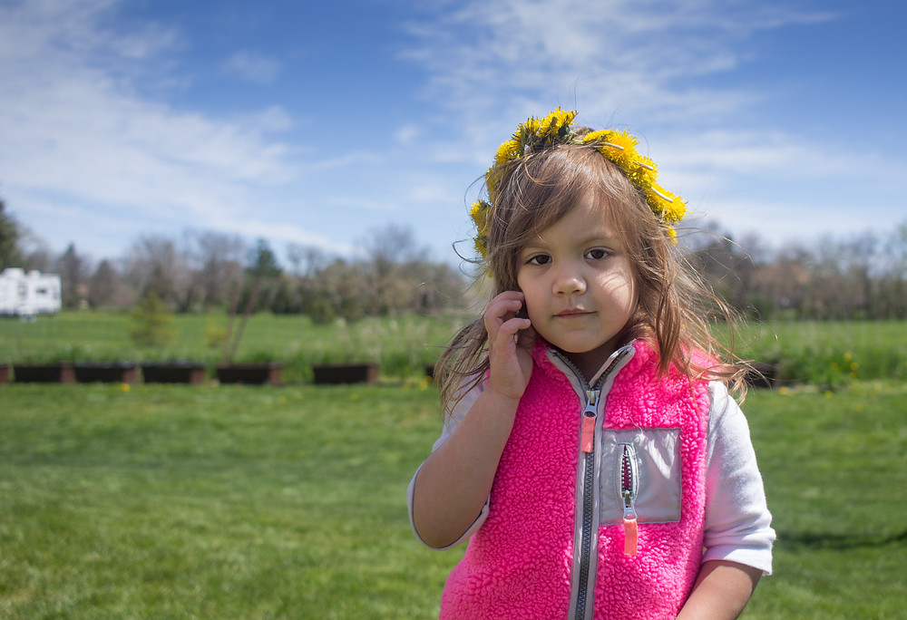 Blue Sky Daycare child with a May Day flower crown
