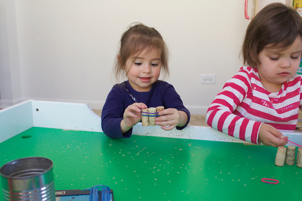 Blue Sky Daycare home daycare children constructing cork boats