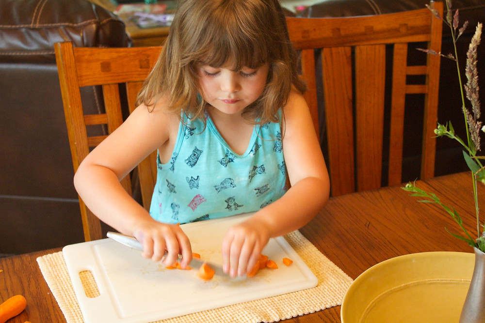 Blue Sky Daycare home daycare child making vegetable soup