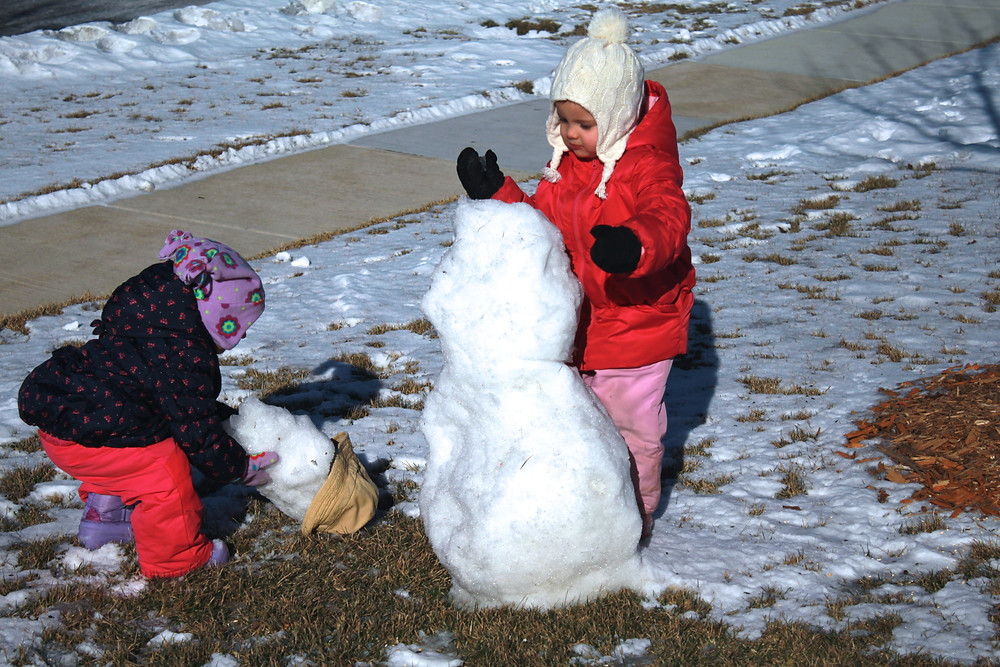 Fixing the snowman at Blue Sky Daycare home dayacare