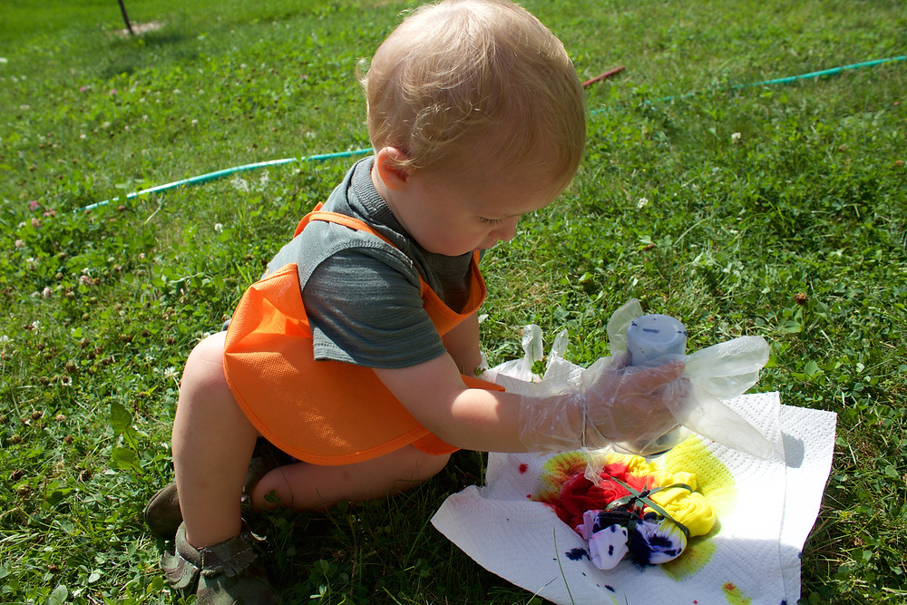 Blue Sky Daycare home daycare children engage in creating tie-dyed clothes