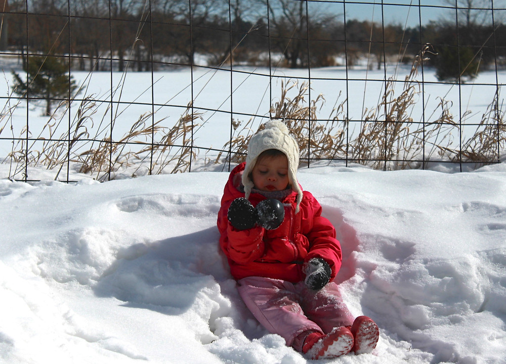 Blue Sky Daycare home daycare child measuring snow