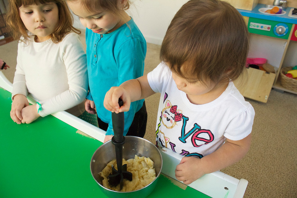 Blue Sky Daycare home daycare kids learn to cook banana bread