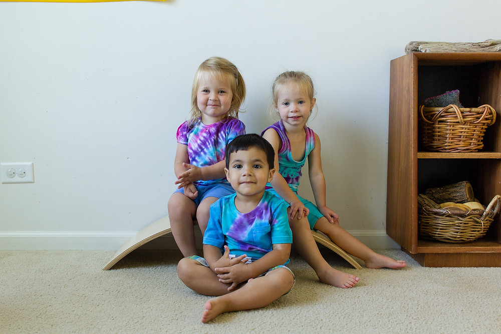Children sport the tie-dye shirts they made at Blue Sky Daycare.