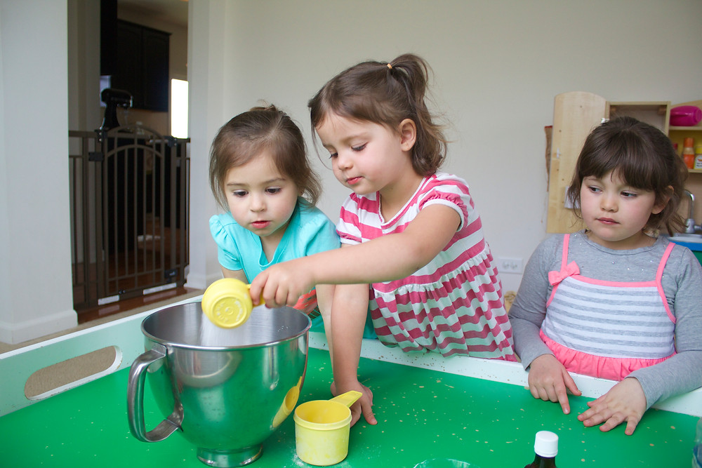 Blue Sky Daycare home daycare children making play dough