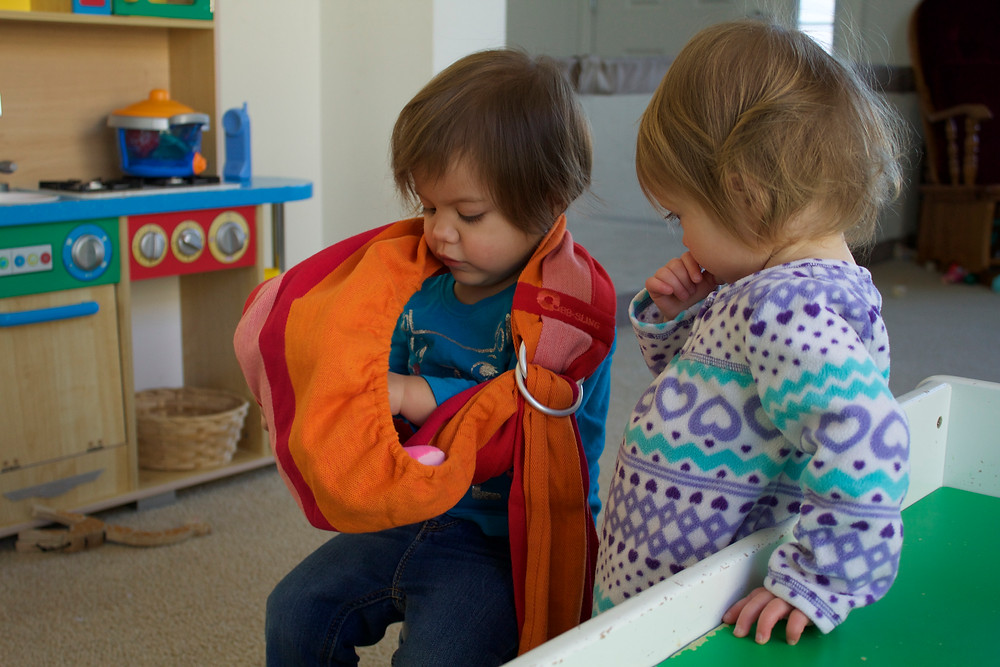 Pretend play with baby dolls at Blue Sky Daycare home daycare