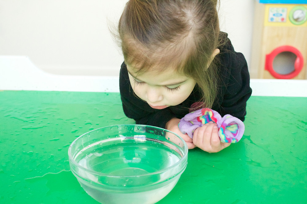 Blue Sky Daycare home daycare children enjoying sensory play with snow