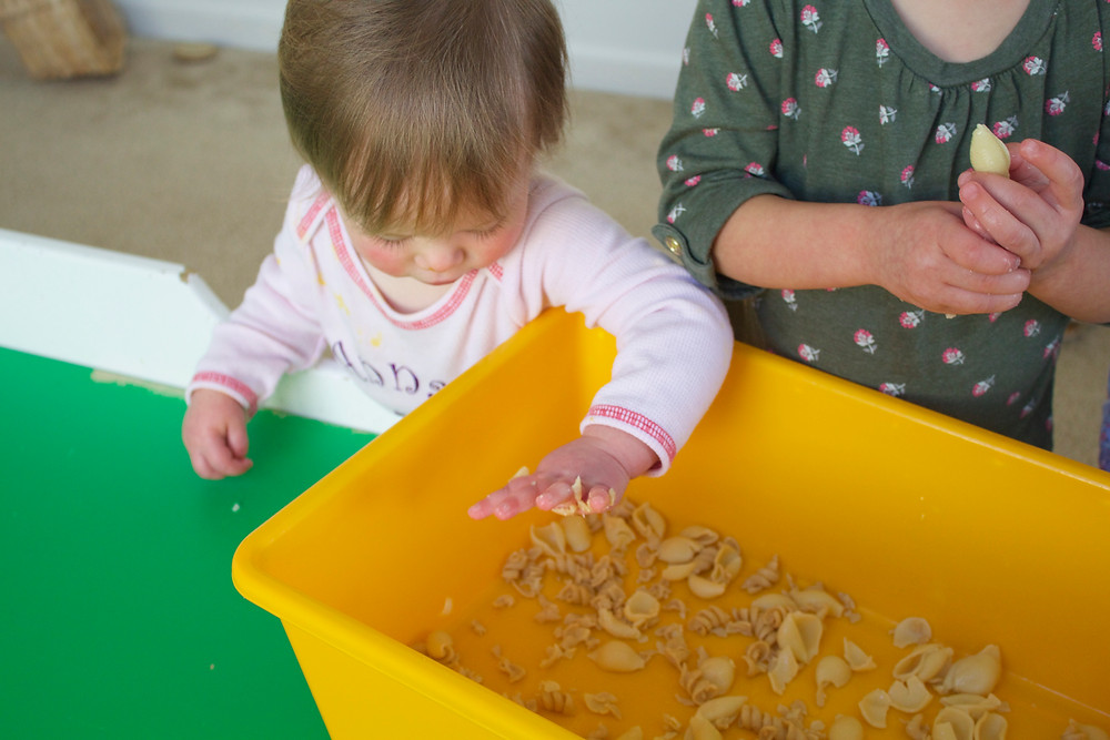 Blue Sky Daycare home daycare child exploring textures during sensory activity