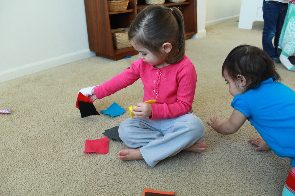 Blue Sky Daycare home daycare children playing a color matching game