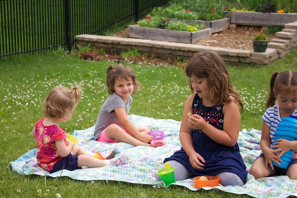 Blue Sky Daycare home daycare children enjoying a picnic