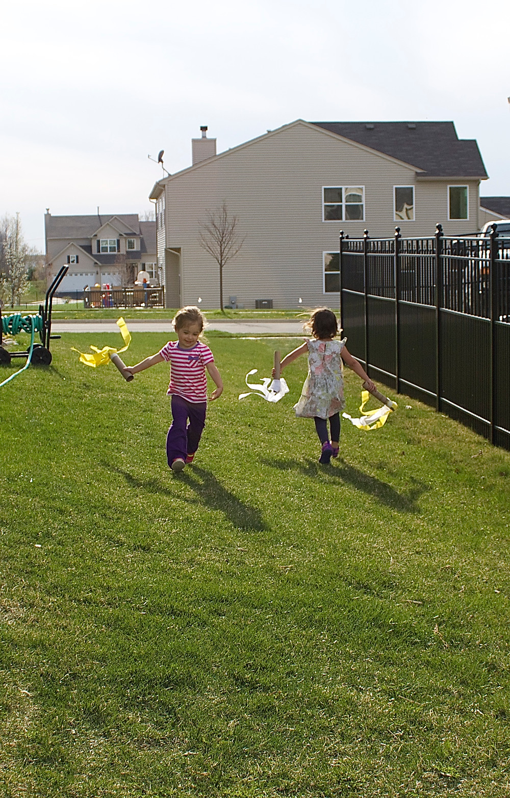 Blue Sky Daycare home daycare children celebrating May Day with dancing wands