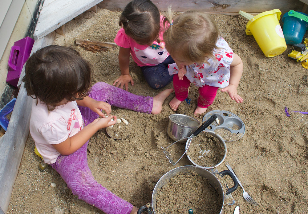 Fun in the sandbox at Blue Sky Daycare home daycare