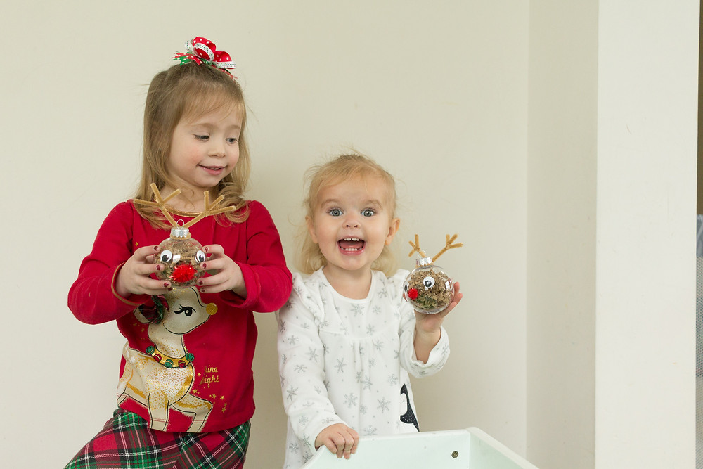Blue Sky Daycare children delight in their handmade ornaments