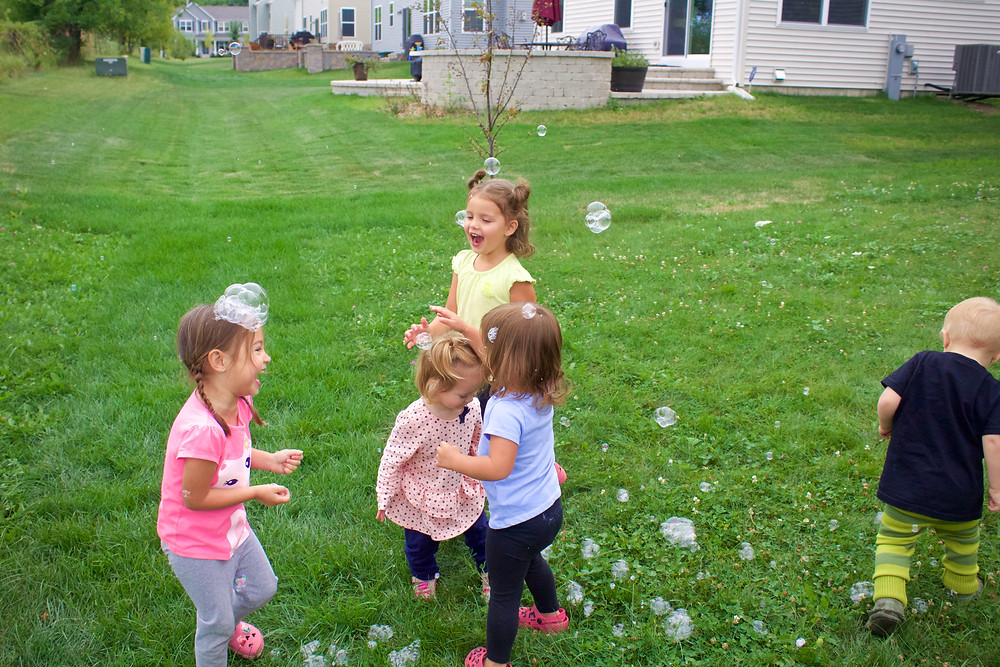 Blue Sky Daycare home daycare children having fun learning about bubbles