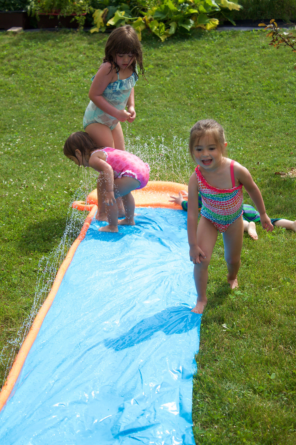 Blue Sky Daycare home daycare children enjoying water play outdoors