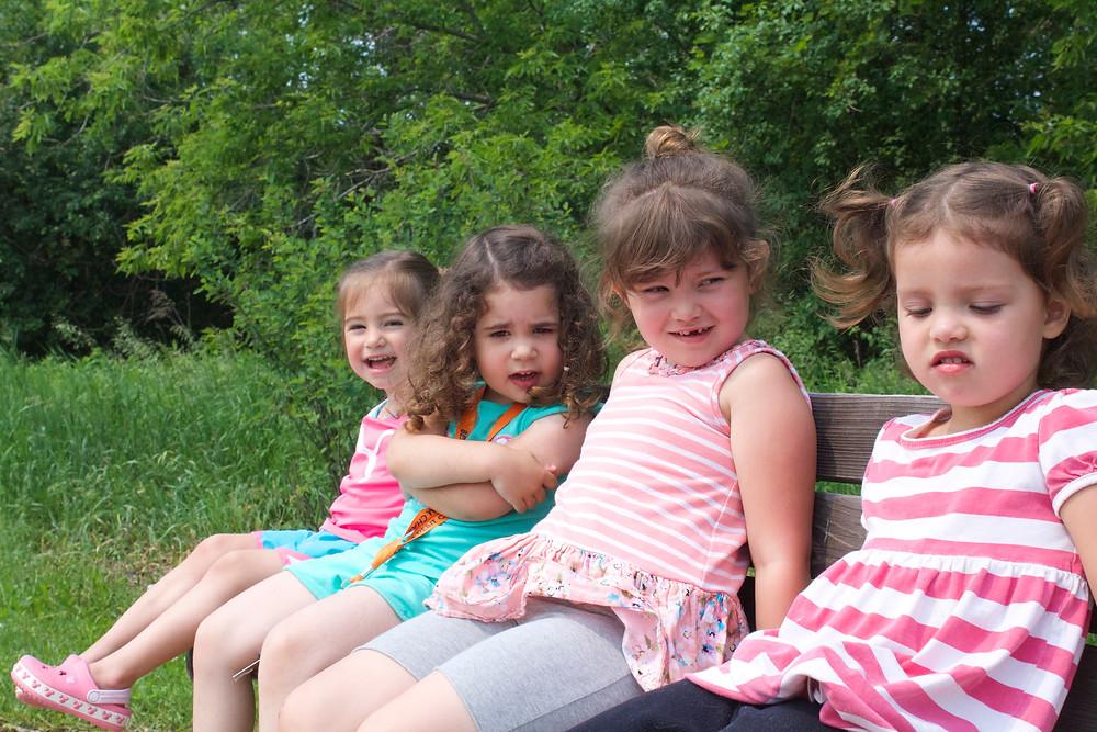 Blue Sky Daycare home daycare children take a break during a nature walk