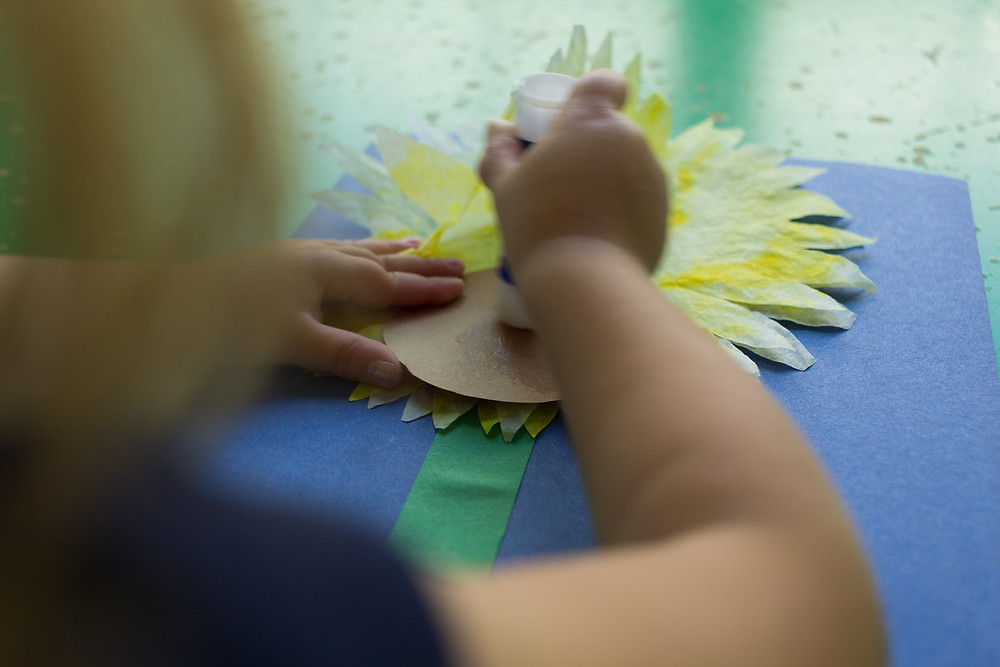 Putting the finishing touches on artwork at Blue Sky Daycare