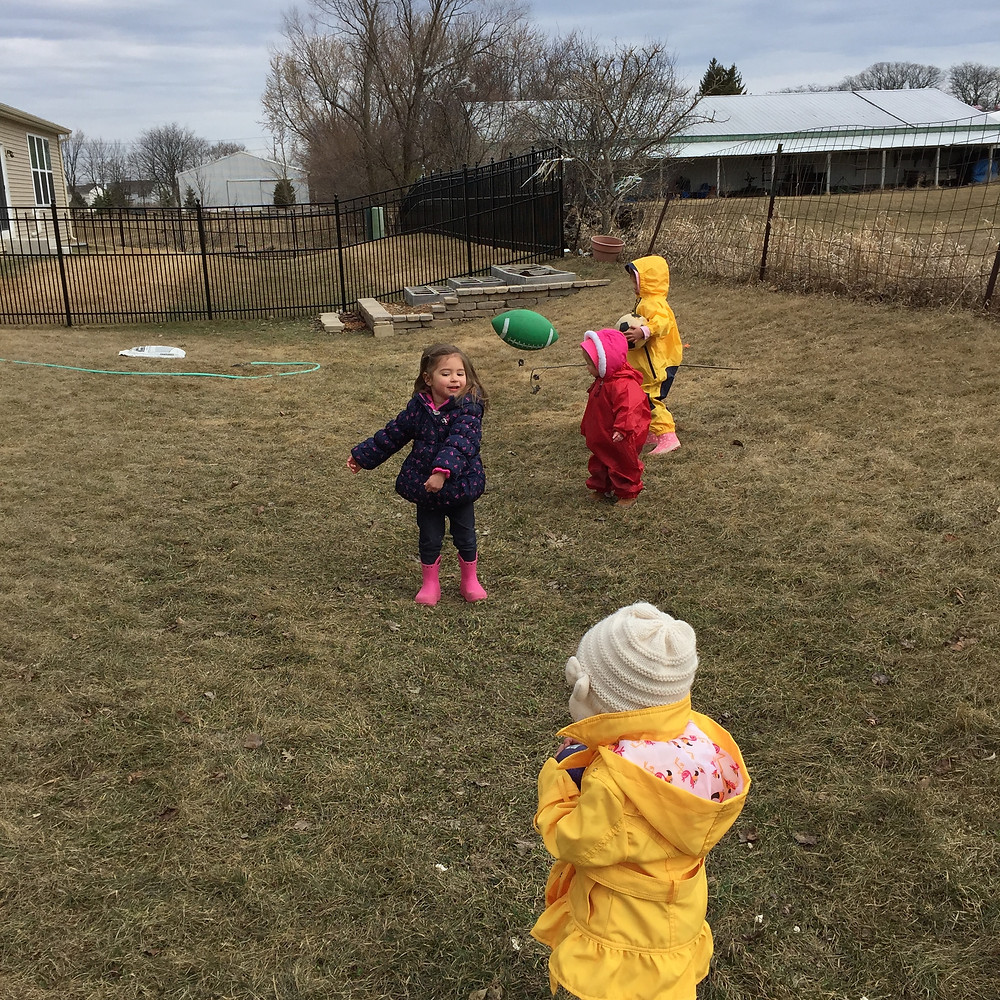 Working on gross motor skills during outdoor play at Blue Sky Daycare home daycare