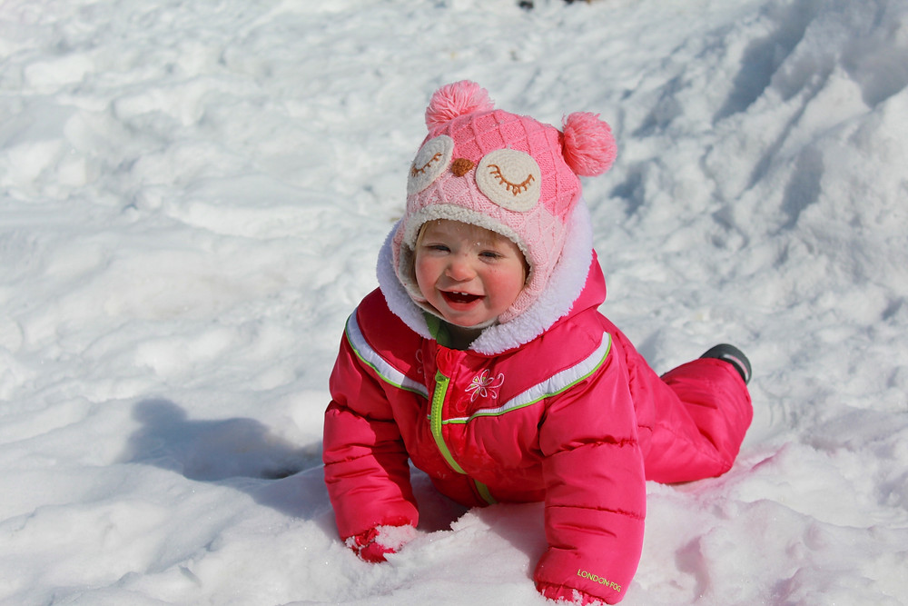 Blue Sky Daycare home daycare child having fun in the snow
