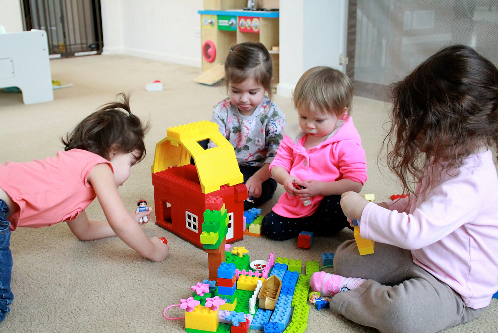 Blue Sky Daycare home daycare children playing with Legos