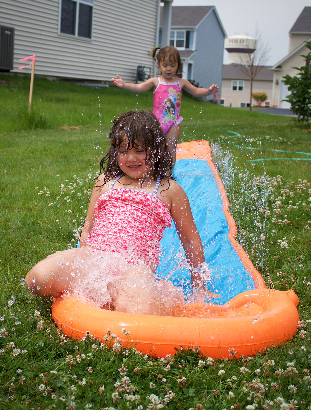 Blue Sky Daycare home daycare children enjoying water play time outdoors