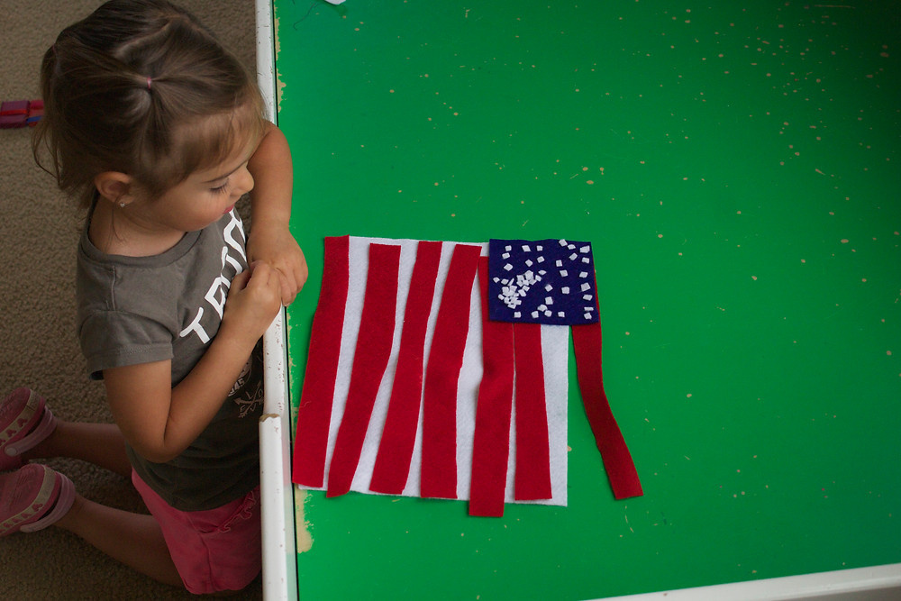 A Blue Sky Daycare home daycare child doing Flag Day crafts