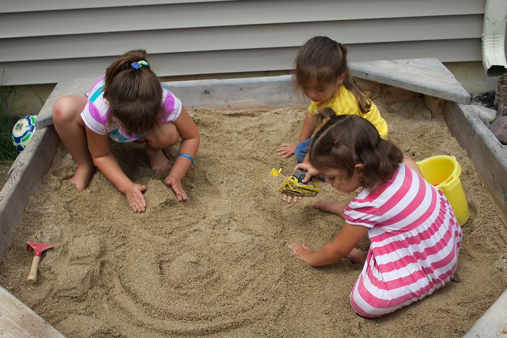Creating a small world of houses and roads at Blue Sky Daycare home daycare