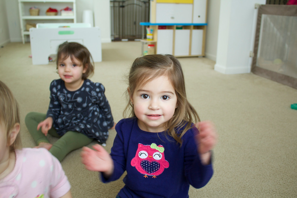 Clapping along during circle time at Blue Sky Daycare home daycare