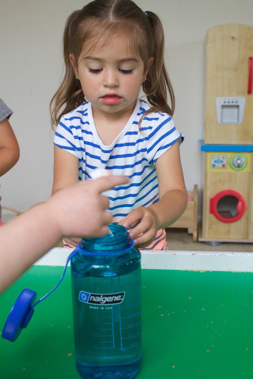 Blue Sky Daycare children preparing homemade iced tea on picnic day