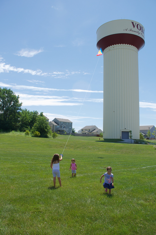 The Blue Sky Daycare home daycare children enjoy flying a kite