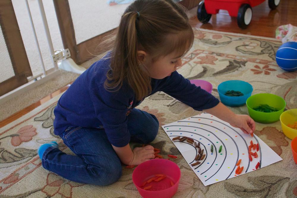 Blue Sky Daycare home daycare child doing a process art activity