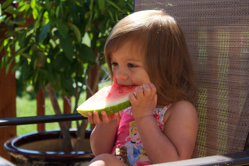 A Blue Sky Daycare home daycare child loves watermelon