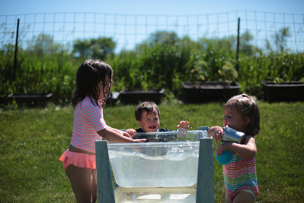 Children enjoy playing in the water at Blue Sky Daycare