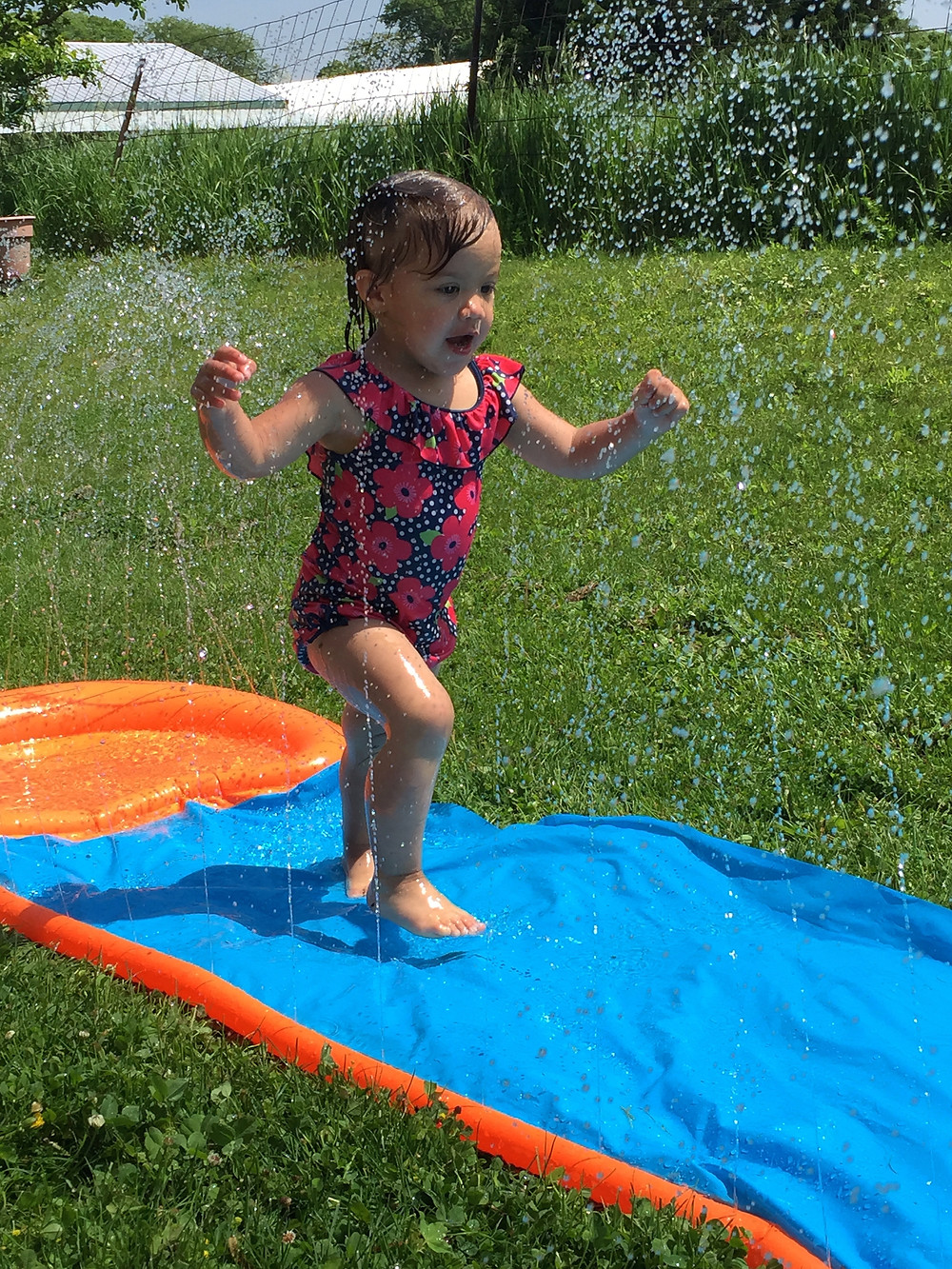 Having a blast with water play at Blue Sky Daycare home daycare