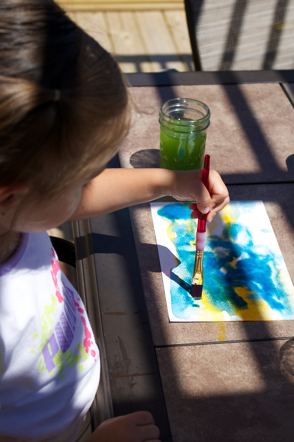 Blue Sky Daycare home daycare children doing watercolor painting