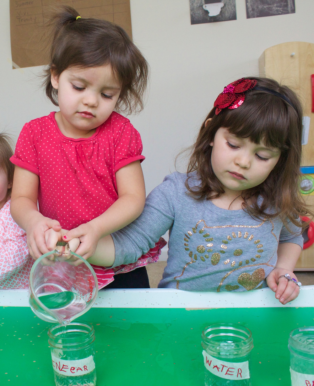 Blue Sky Daycare chilren engaged in a science experiment- cleaning pennies