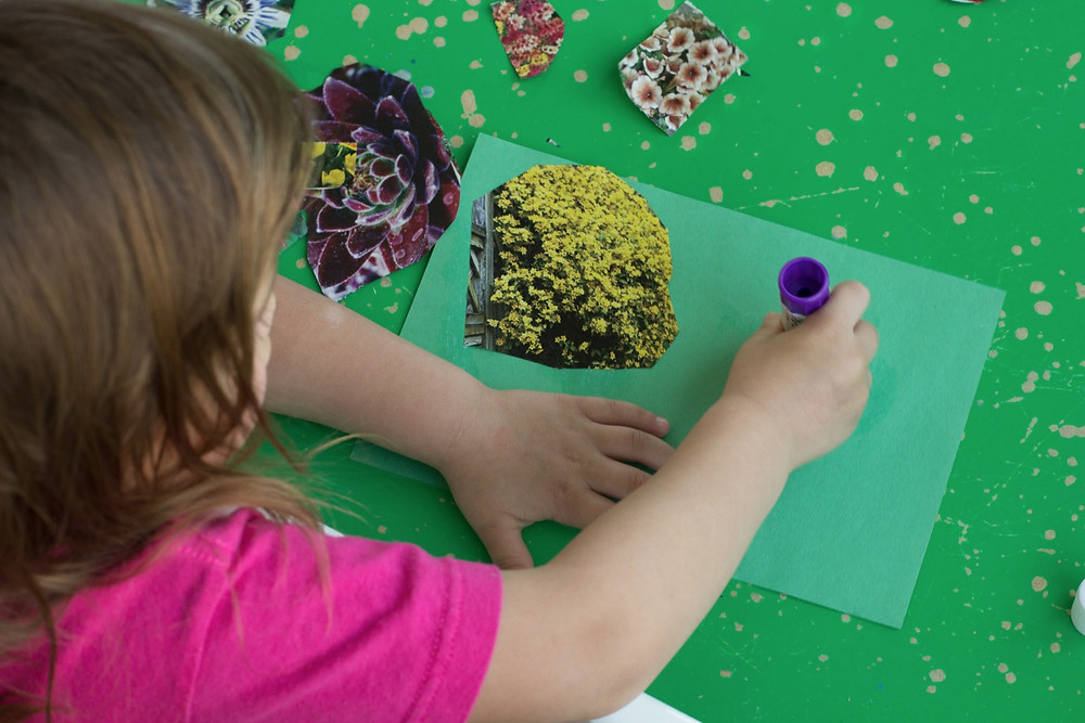 "Cutting and Pasting- Blue Sky Daycare children create a floral collage ""garden"""