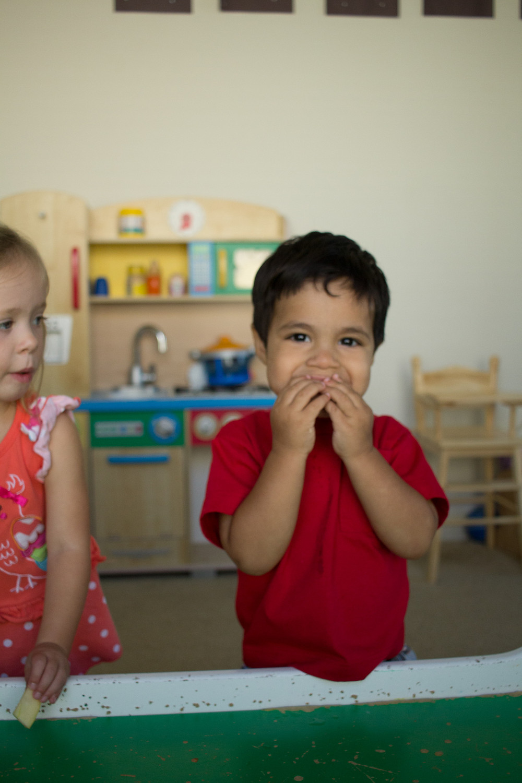 A Blue Sky Daycare child enjoys an apple taste test.