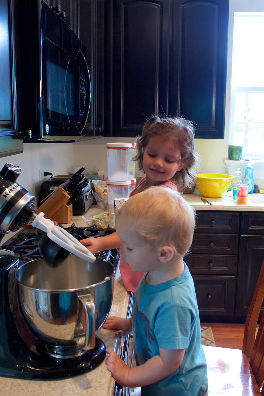 Blue Sky Daycare home daycare children make 10-grain muffins